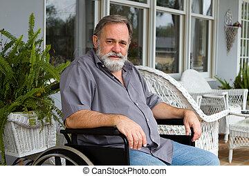 Paraplegic Man - Disabled paraplegic man sits depressed in...
