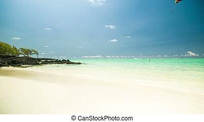 Parasailer at beach in Mauritius