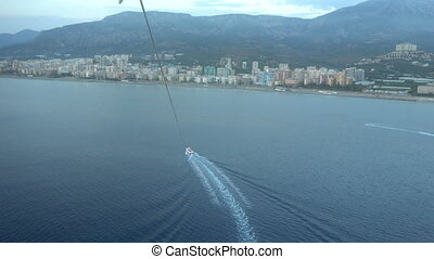 Parasailing above the Mediterranean sea.