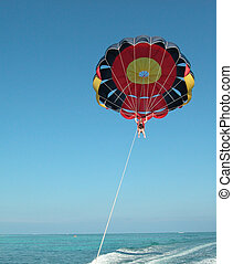 Woman parasailing at Punta Cana in the Dominican Republic.