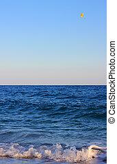Parasailing at sea on sunny day