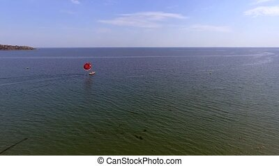 Parasailing in Black Sea in front of sandy beaches in...