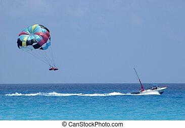 Parasailing over Can - Parasailing over the Caribbean Sea,...