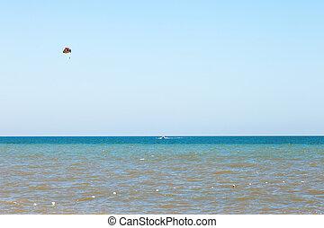 Parasailing over water Sea of Azov, Golubitskaya, Russia