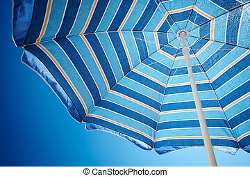 Parasol against deep blue sky