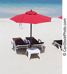 parasol and sunbeds on the sea