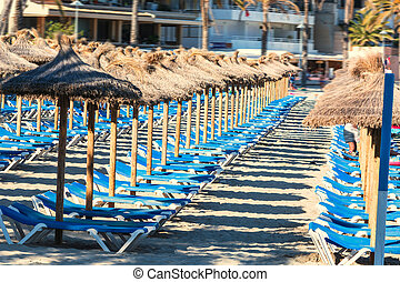 Parasol sea and sunbeds on the beach