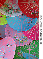 Close shot of multi color traditional Chinese umbrellas