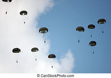 paratrooper - Skydivers jump on a cloudy sky