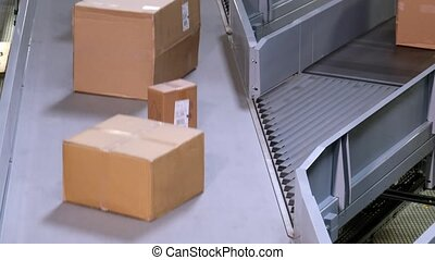 Parcels merging on conveyors - time lapse - Parcels merging...