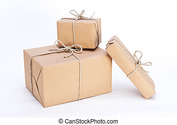 packages ready for shipment, wrapped in brown paper and tied with string
