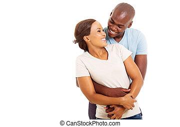 pareja, africano, se abrazar