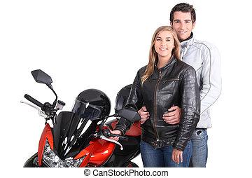 pareja, al lado de, moto