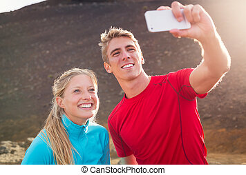 pareja, atlético, foto, selfie, joven, atractivo, teléfono, ...