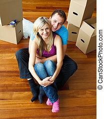 pareja, casa, mudanza, alto, floor., ángulo, sentado