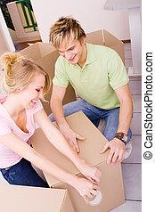 pareja, embalaje, cajas