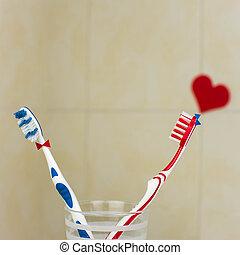 pareja, enamorado, de, dos, toothbrushes.