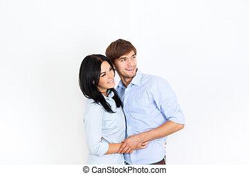 pareja joven, en casa, pared