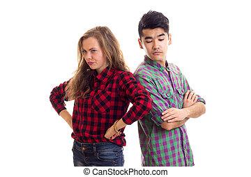 pareja joven, en, tartán, camisas