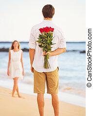 pareja joven, enamorado, hombre, tenencia, sorpresa, ramo de rosas, para, hermoso, mujer joven, romántico, fecha