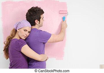 pareja joven, pintura, bebé, guardería infantil, en, nuevo hogar