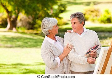 pareja jubilada, pintura, en el parque