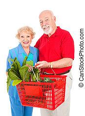 pareja mayor, tiendas, sano