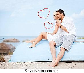 pareja, sentado, en, barco, en el mar, lado
