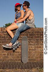 pareja, skateboarder