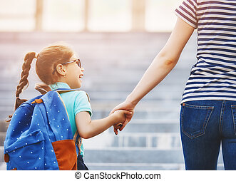 Parent and pupil go to school