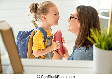 Parent and pupil of preschool. Woman and girl with backpack ...