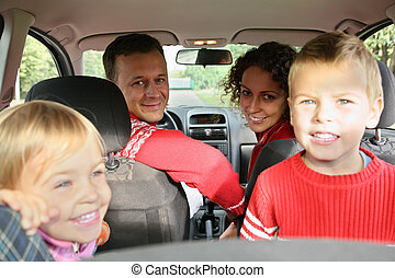 parent with child in car