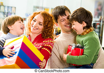 Parental care - Image of happy parents holding their...
