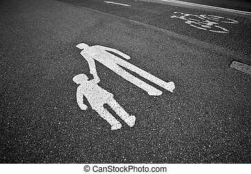 parental guidance concept - pedestrian sign on the pavement/...