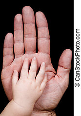 Parenthood - two hands with father and his baby son