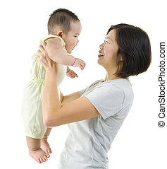 Parenting - Asian mother playing with her baby boy