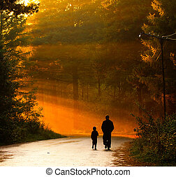 parenting - father and son walking in the sunlight