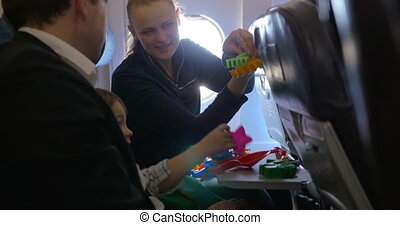 Parents and child playing in the plane