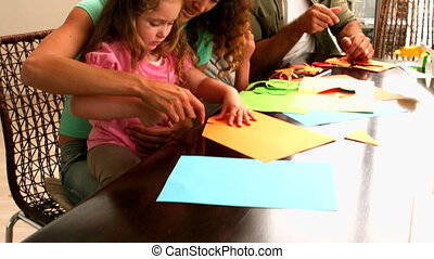 Parents and children making paper s