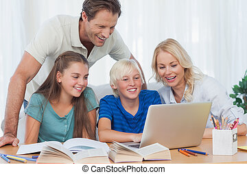 Parents and children using a computer