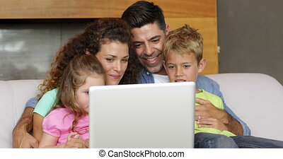 Parents and children using the laptop