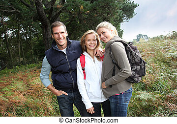 Parents and daughter walking in the countryside