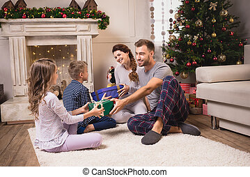 parents and kids on christmas