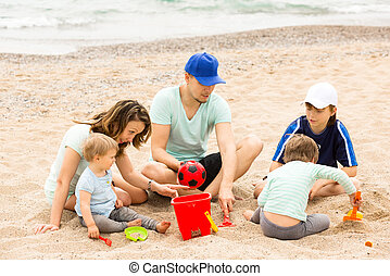 Parents and kids playing with sand