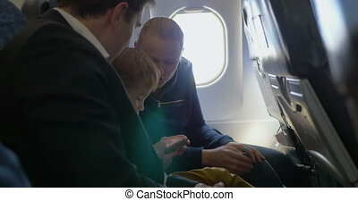Parents and little son traveling by air