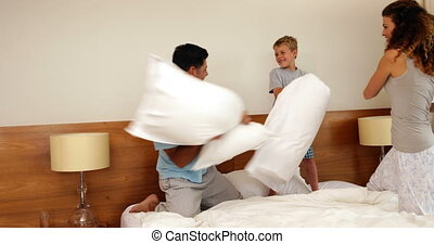 Parents and son having a pillow fight