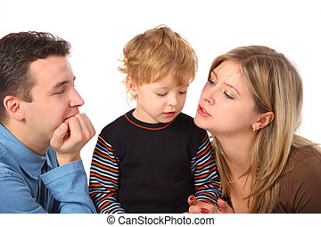 Parents and son talking on white