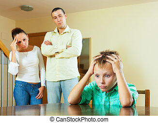 Parents and teen son after quarrel at home - Parents and...