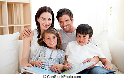 Parents and their children reading a book