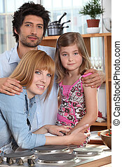 Parents and their daughter in the kitchen
